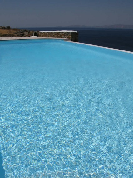 The infinity swimming pool at Vega Apartments in Tinos, Greece