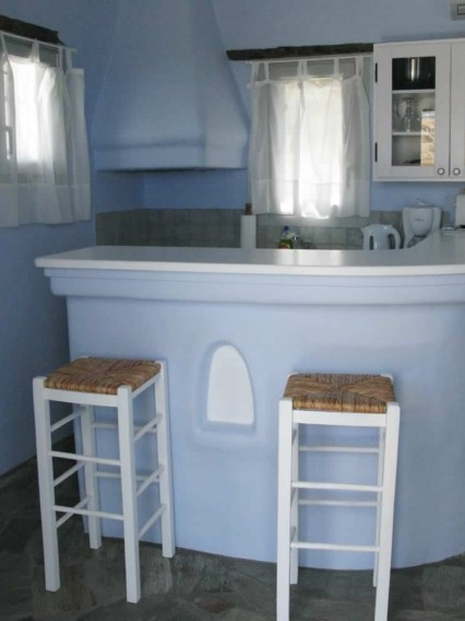 Deneb, Bedroom with double bed, bathroom, kitchen/lounge with settee/beds, TV, Vega Apartments in Tinos island, Cyclades