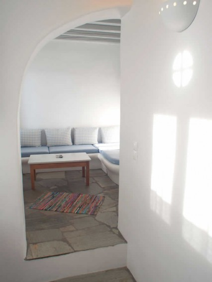 Rigel, Duplex apartment. Ground Floor: Bedroom with 2 single beds, bathroom, kitchen, lounge with settee/beds, TV, & First Floor: Bedroom with double bed, en-suite bathroom, TV and cute balcony, Vega Apartments in Tinos island, Cyclades