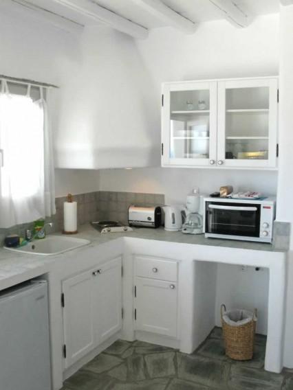 Vega studio, double lit et cuisine américaine admirablement disposés dans un espace unique, TV, une salle de bains,Vega Apartments in Tinos island, Cyclades